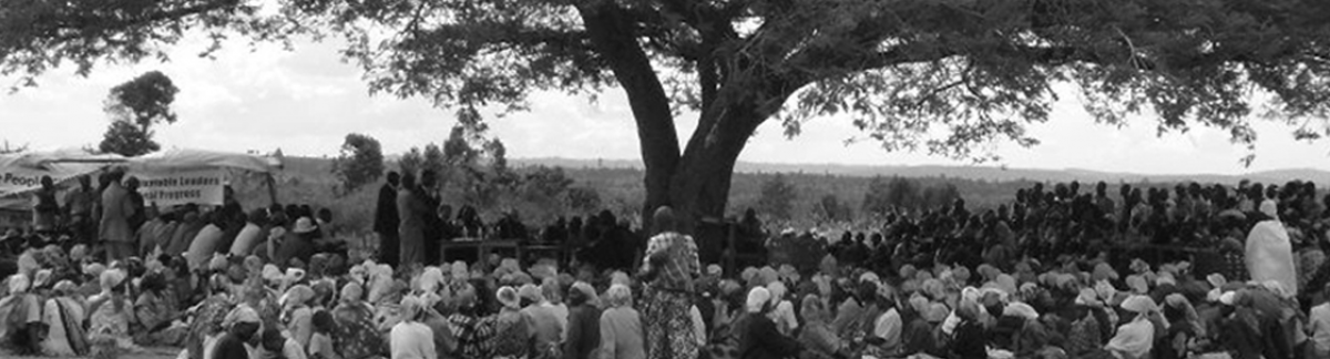 Group of People Under a Large Tree